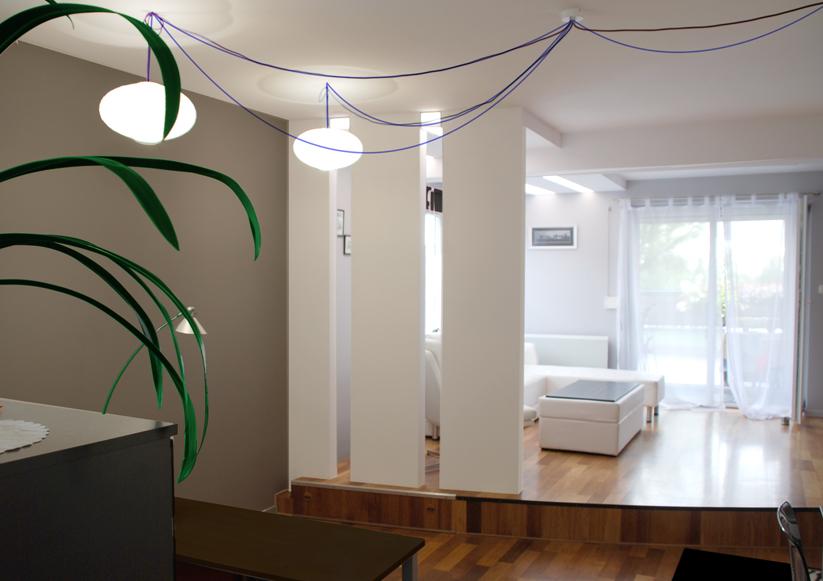 aranżacja mieszkania widok na salon ze ściankami działowymi i oświetleniem sufitowym Barisol Światło